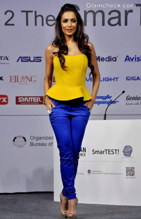 malaika arora yellow peplum  top blue denims color block trend 2012