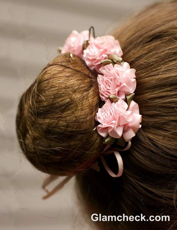Indian bun hairstyles with fowers