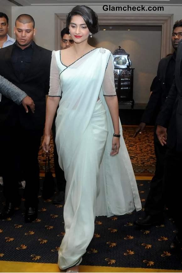 Sonam Kapoor white sari at The Filmfare Award Press Conference in Bangalore