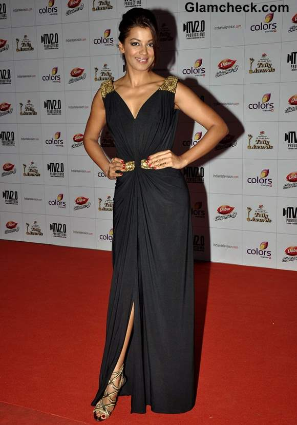 Mugdha Godse Sports Gold and Black Gown at Indian Telly Awards 2013