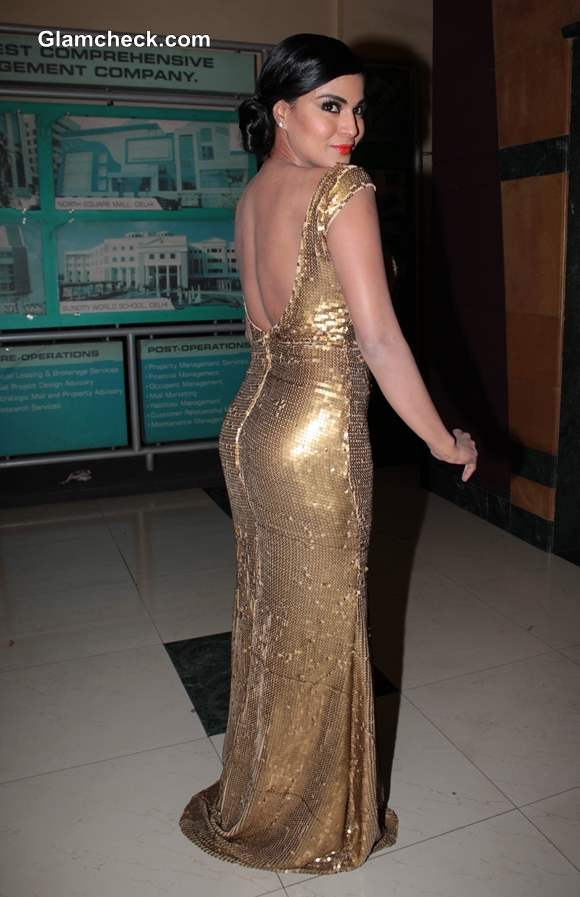 Veena Malik in backless golden gown at Premiere of Real Life of Super Model