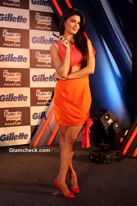 Jacqueline Fernandez in orange dress at Unveiling of Gillette New Shaving System