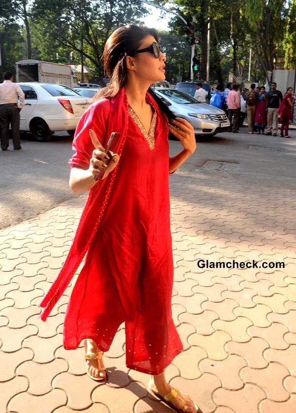 Jacqueline Fernandez in red suit Fights to Ban Horse-drawn Carriages in Mumbai