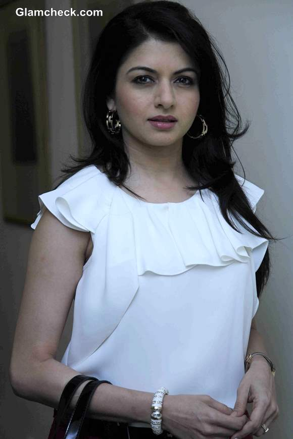 Bhagyashree Pairs a Frilly white Top with Maroon Denims
