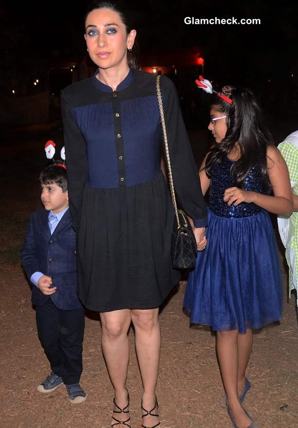 Karisma Kapoor with her kids at the Midnight Mass on Christmas Eve 2013
