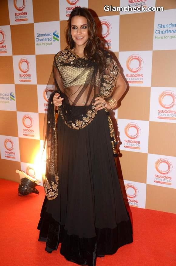 Neha Dhupia in Gold and Black Lehenga at 2014 Swades Foundation Fashion Show