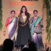 Neha Dhupia in Gold and Black Lehenga at Swades Foundation Fashion Show