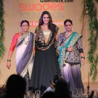 Neha Dhupia in Gold and Black Lehenga at Swades Foundation Fashion Show