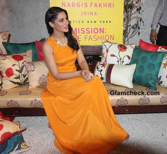 Nargis Fakhri Lights Up the Room in Orange Maxi