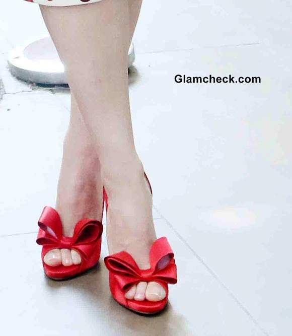 Red peep-toed pumps with bow detailing by Valentino