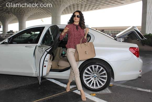 Kangana Ranaut pairs Nude Colored Trousers with a Printed Blouse