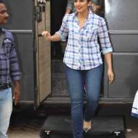 Huma Qureshi wears classic plaid shirt with blue jeans