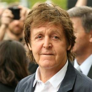 Sir Paul McCartney trips on stage