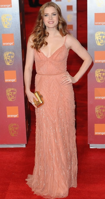 Amy Adams glows in coral at 2011 BAFTA Awards