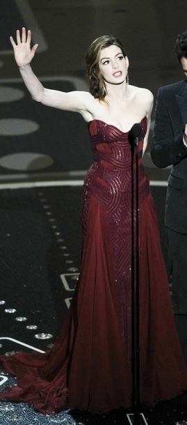 Anne Hathaway Flaunts Seven Outfits On Stage At 2011 Oscars
