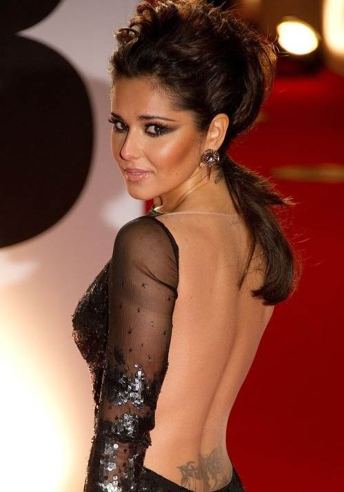 http://cdn.glamcheck.com/entertainment/files/2011/02/Cheryl-Cole-in-stunning-backless-gown-at-2011-BRIT-Awards.jpg