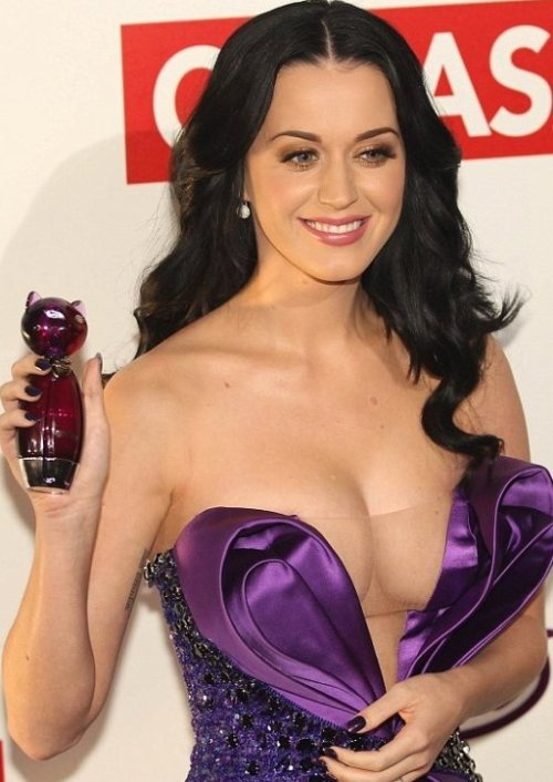 Katy Perry in cleavage revealing dress at fragrance launch