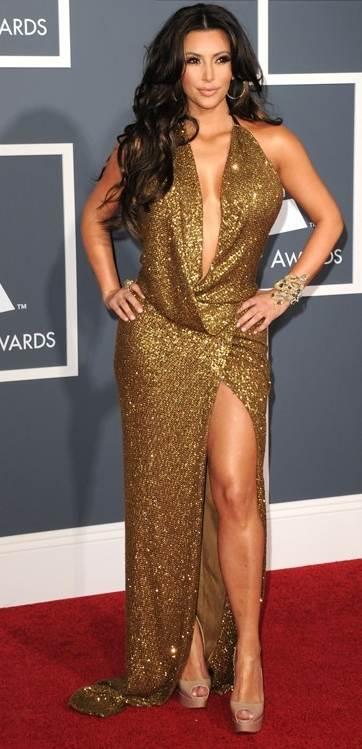 Kim Kardashian in golden metallic gown at 2011 grammy awards