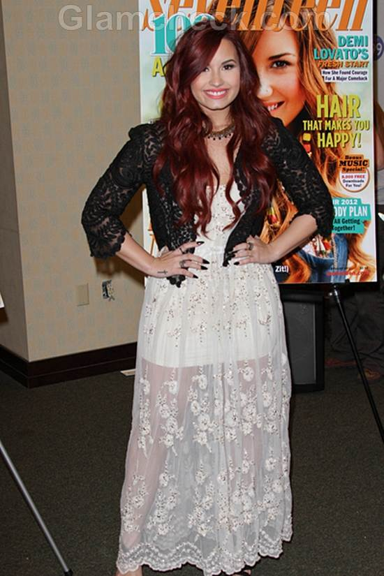 Demi Lovato Feminine in Black  White at Seventeen Magazine Signing