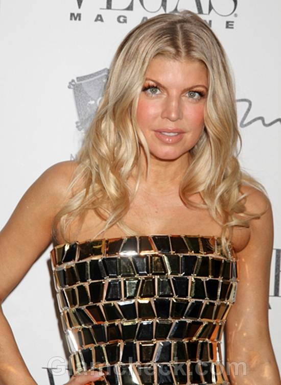Fergie Dazzles Strapless Gold Dress at New Years Eve bash