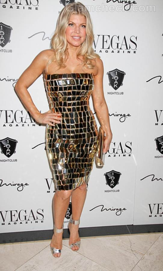 Fergie Dazzles in Strapless Gold Dress at New Years Eve bash