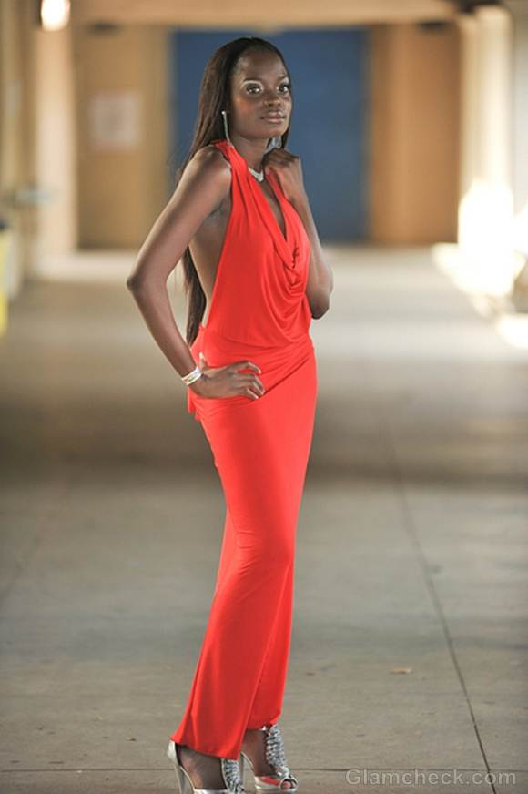 Nimi Scorches Red Carpet in Backless orange Gown