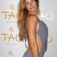 Kelly Bensimon red carpet in swimsuit