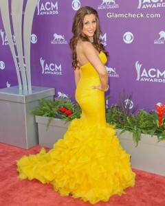 Red Carpet Sunshine: Danielle Peck Vibrant in Yellow Fishtail Gown at Country Music Awards