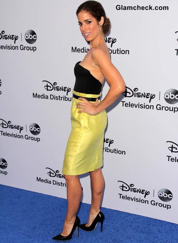 Ana Ortiz in yellow black outfit