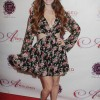 Phoebe Price in floral print dress at Aroused Premiere
