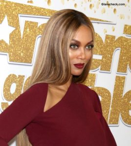 "Tyra Banks dons a Burgundy Gown at the ""AGT"" Live Show Red Carpet"