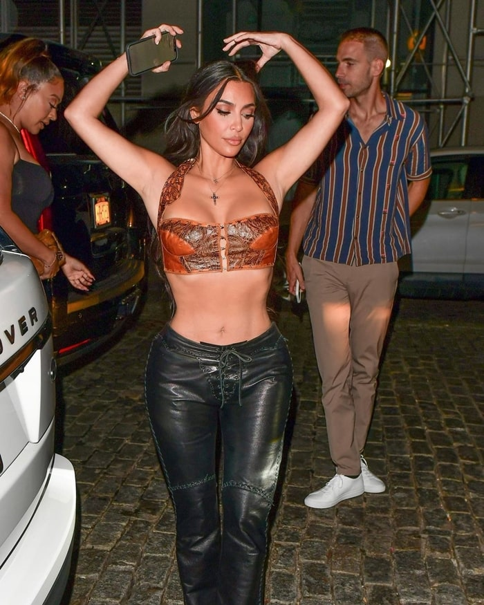 Kim Kardashian Wears Leather Bustier Top with Pants Cowgirl Look 2021