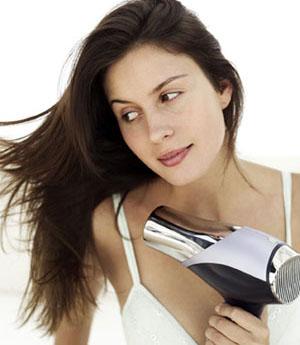 blow-drying hair
