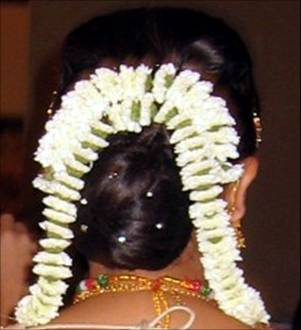 Indian bridal hairstyles / flower adornment