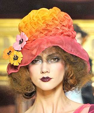 colorful hats with floral embellishments spring summer 2011 John Galliano