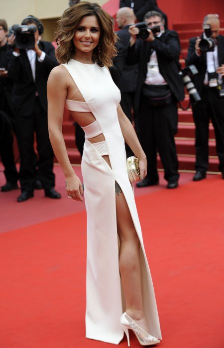 Which celebrity\'s white cut-out gown is more daring: Cheryl or Gwyeneth
