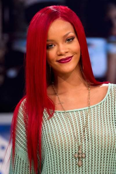 rihanna hair 2011 pics. Rihanna+long+red+hair+2011