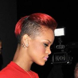 Rihanna side cropped red hair june 2010