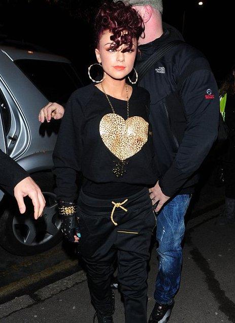 cher lloyd 2011 tattoos. Cher Lloyd debuts funky