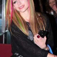 Avril Lavigne sports pink green streaked hair