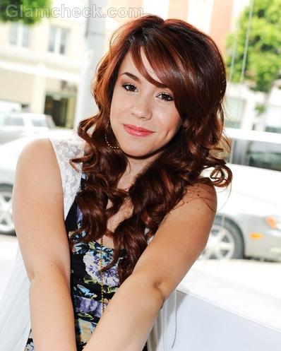 Jillian-Rose-Reed-curly-side-swept-hair