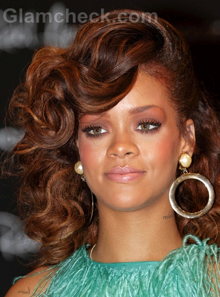 Rihanna Sports Side Swept Curly Hairstyle