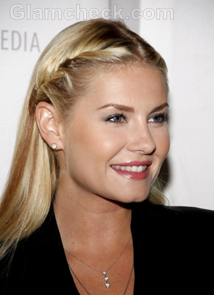 elisha cuthbert in a front twisted hairstyle