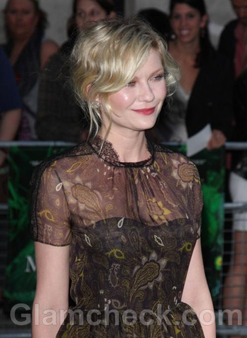 Kirsten-Dunst-Demure-in-50s-Inspired-Dress-at-Melancholia-Premiere