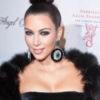 Kim-Kardashian-Sleek-Top-Knot-hairstyle