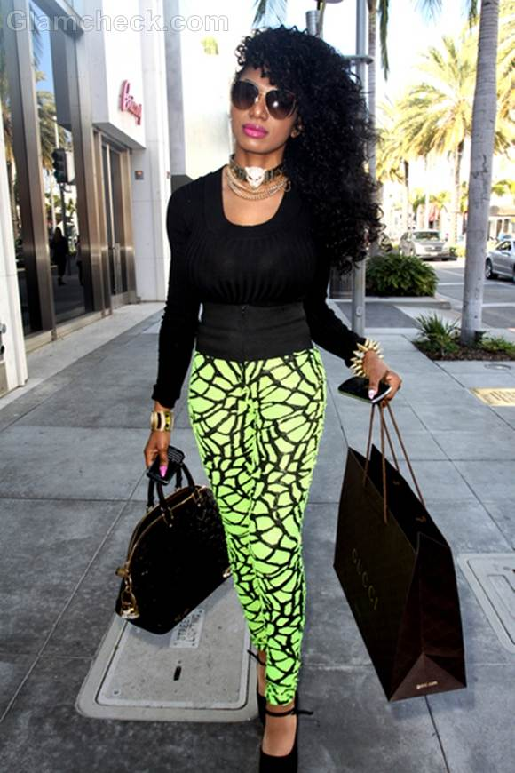 Dencia Resplendent in fluorescent pants While Shopping
