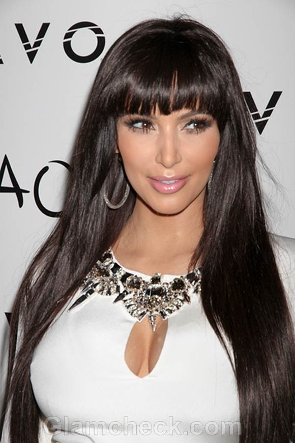 Kim Kardashian Sports Sexy New Haircut blunt bangs for 2012