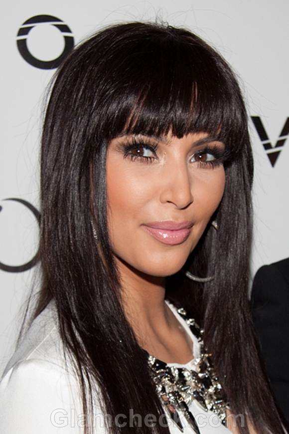 Kim Kardashian Sports Sexy New Haircut for 2012 - Blunt Bangs