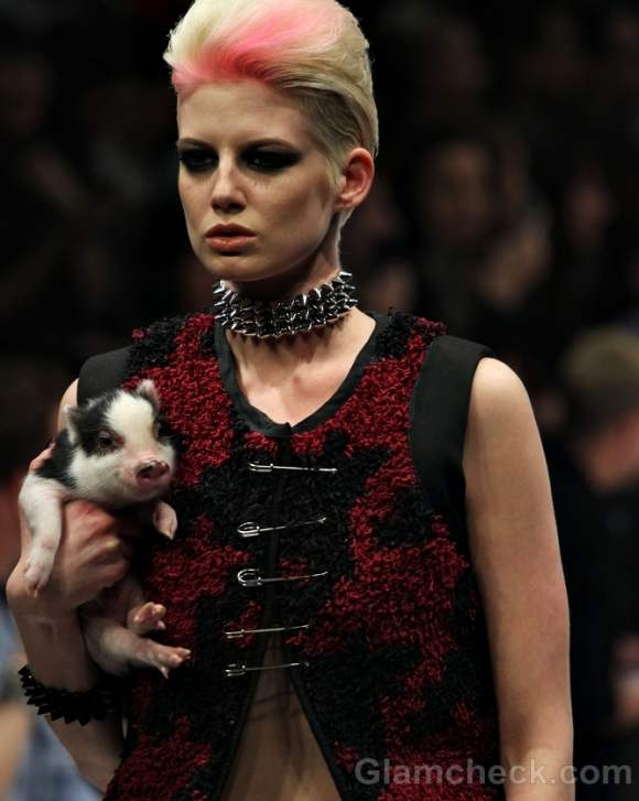 Models walk the ramp with cute piglets