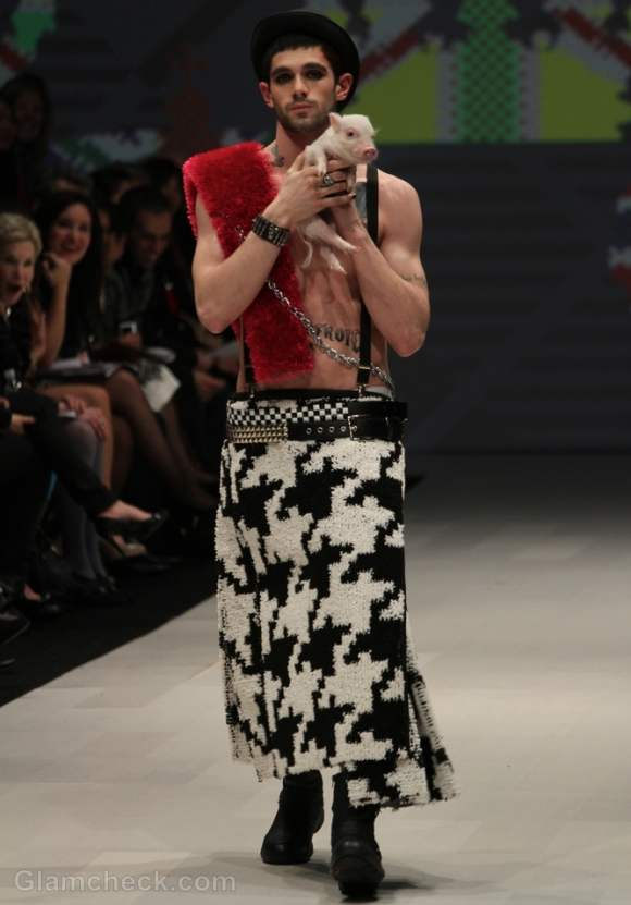 Models walk the ramp with piglets